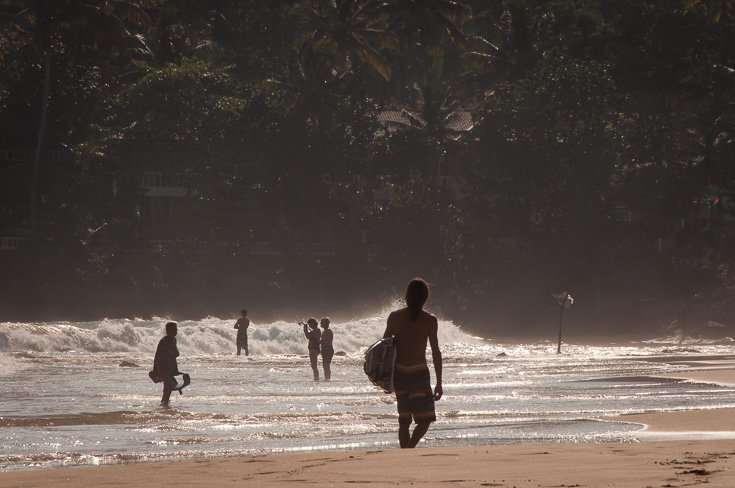 Surfer at Mirissa beach, Sri Lanka