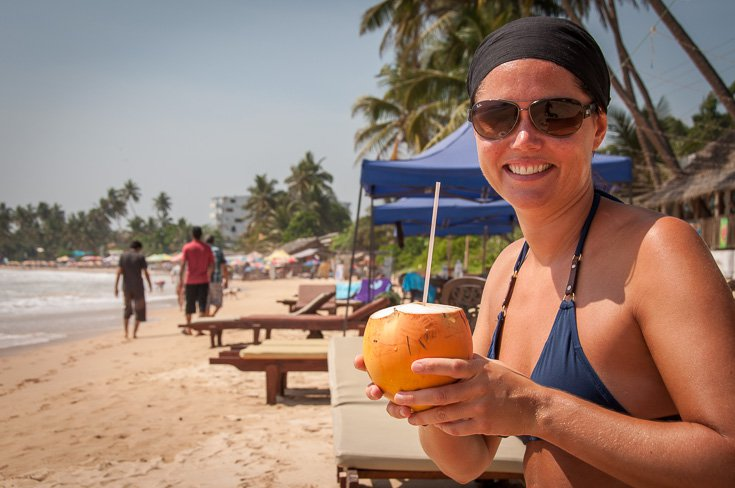 Maria drinking coconut at Mirissa beach, Sri Lanka