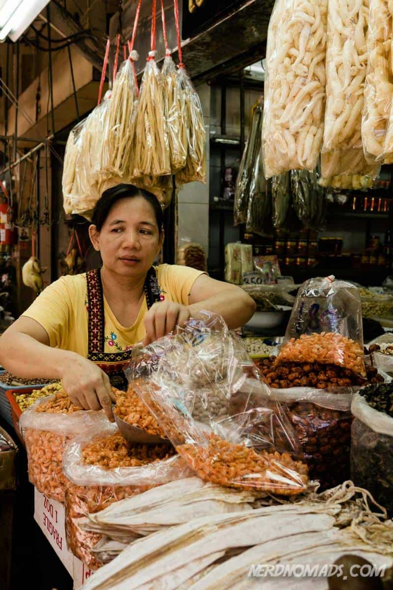 A woman selling different dried things at Sampeng Market in Yaowarat Chinatown Bangkok