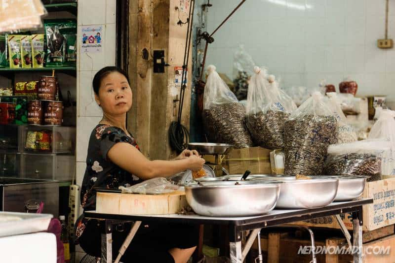 A woman selling spices and tea at Sampeng Market in Chinatown Bangkok