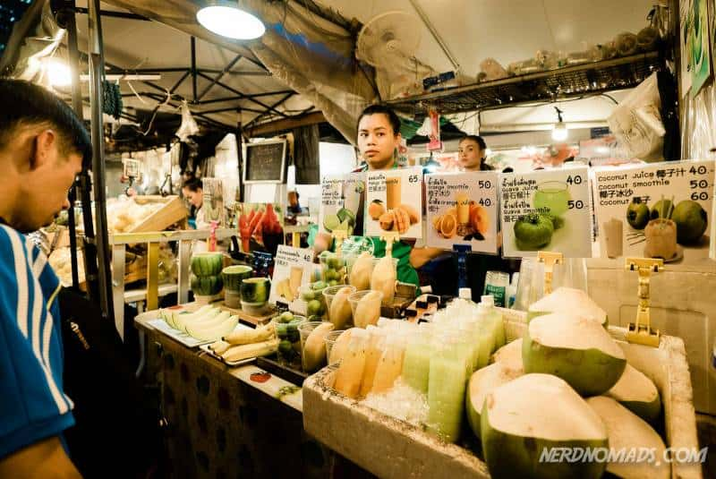 Coconuts, juice, fruits, and mango sticky rice at Ratchada Train Night Market in Bangkok