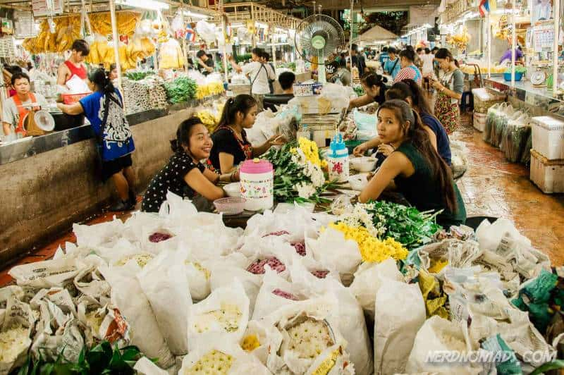 Girls sorting flowers at Pak Khlong Talat Flower Market in Bangkok