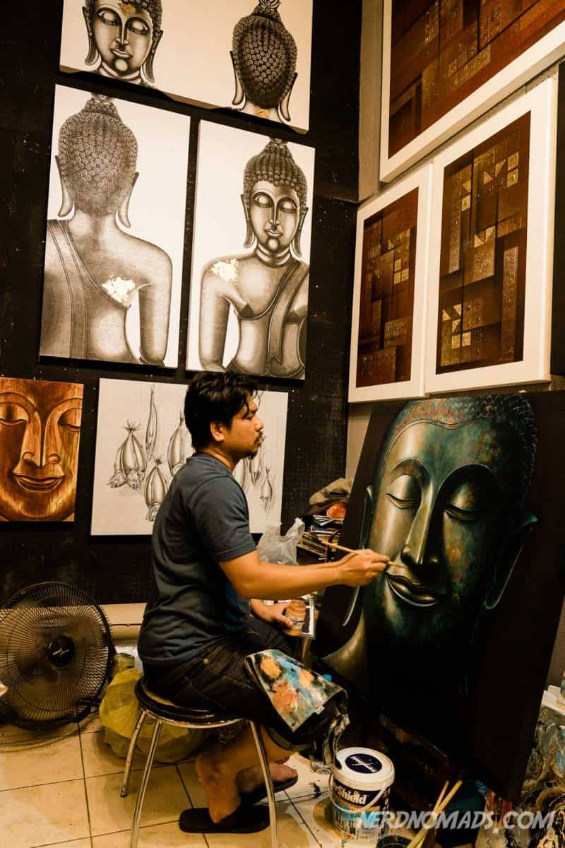At the art section of Chatuchak market in Bangkok, you can watch the artists paint their art