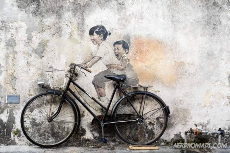Kids on a bicycle street art George Town Penang