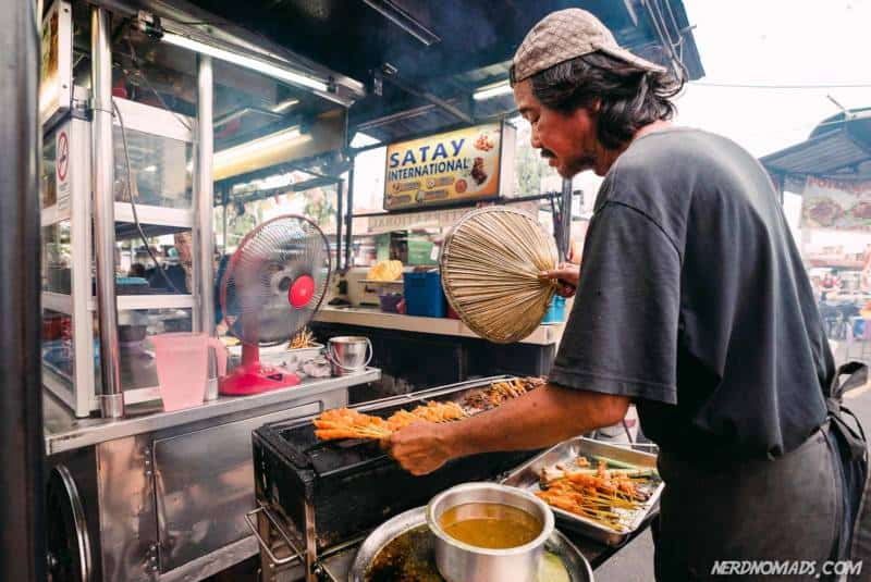 Cooking ups some delicious chicken satay at Gurney Drive Hawker Center