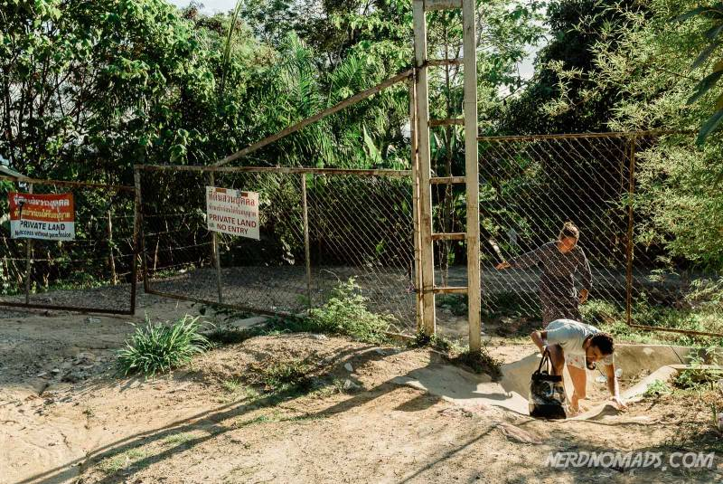 To get to Freedom Beach in Phuket, Thailand you have to go under a fence