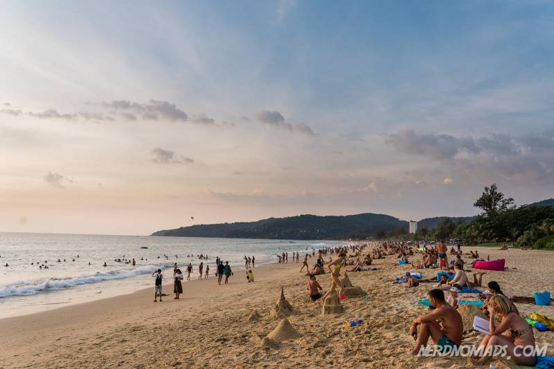 Lots of people at Karon Beach in Phuket enjoying the beautiful sunset