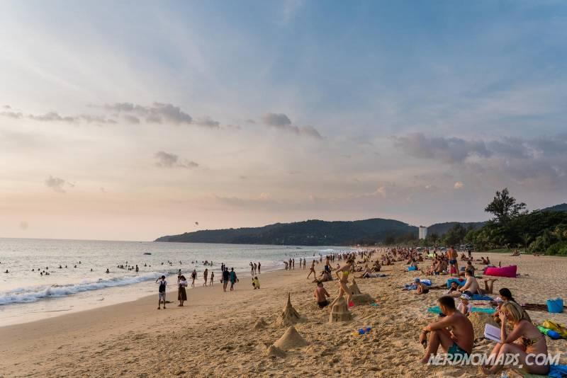 Lots of people at Karon Beach in Phuket enjoying the beautiful sunset