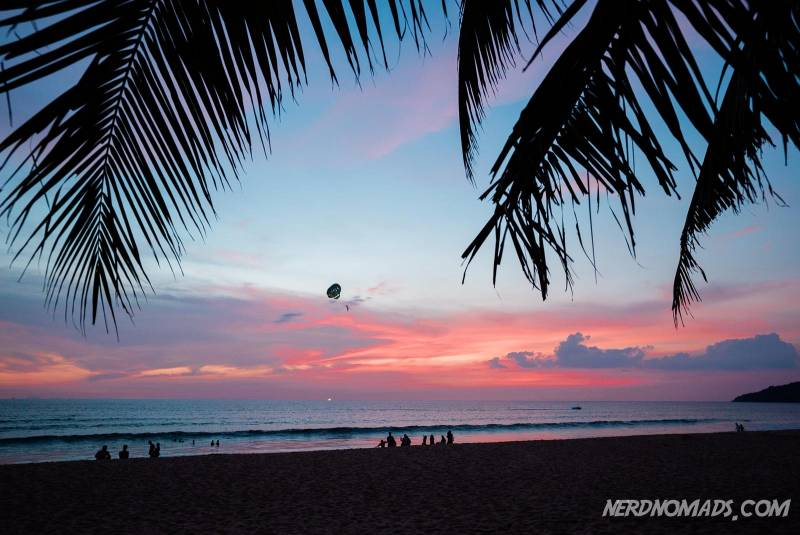 Palmtrees and a stunning sunset at Karon Beach Phuket