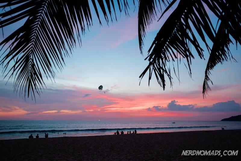 Palmtrees and a stunning sunset at Karon Beach Phuket