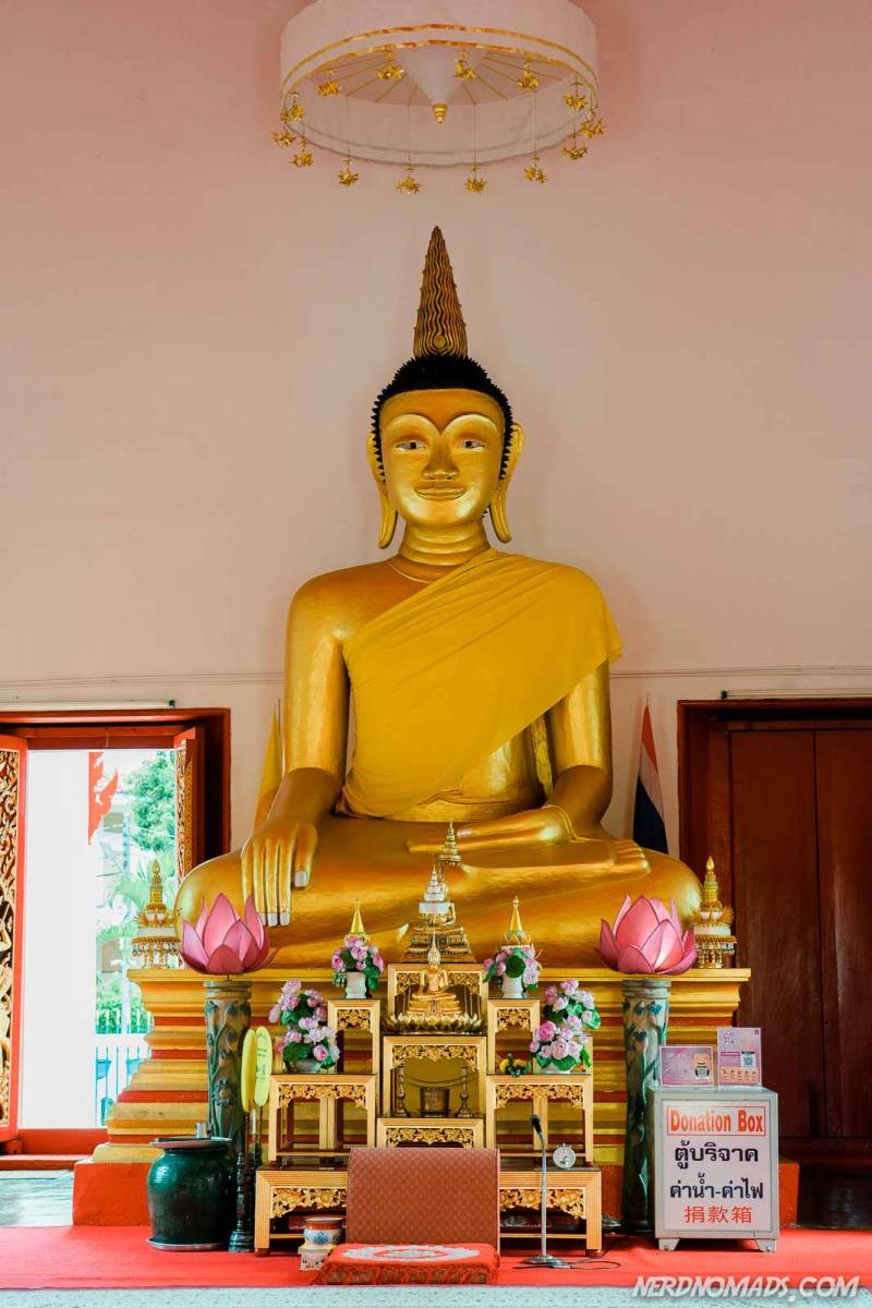inside Wat Mongkol Nimit is a budha statue