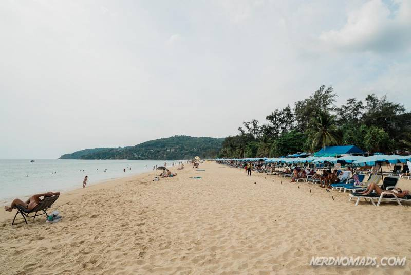 You can rent sun beds at the southern part of Karon Beach Phuket