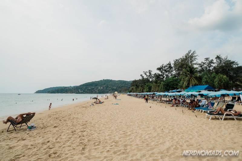 You can rent sun beds at the southern part of Karon Beach Phuket