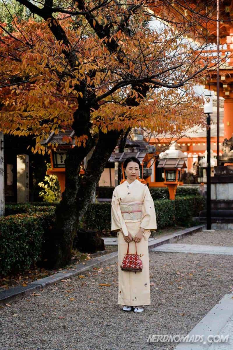 Girl in kimono posing at Yasaka-jinja Shrine in Kyoto
