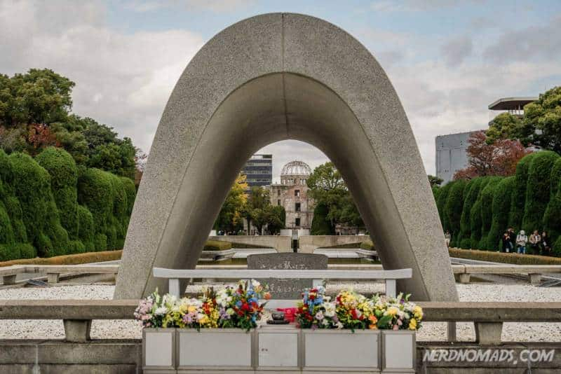 The three peace element in line hiroshima victims memorial cenotaph flame of peace and atomic bomb dome