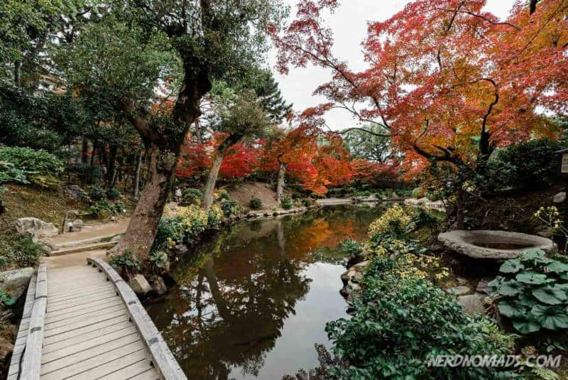 Walking path through autumn leaves in Shukkeien Garden Hiroshima Japan