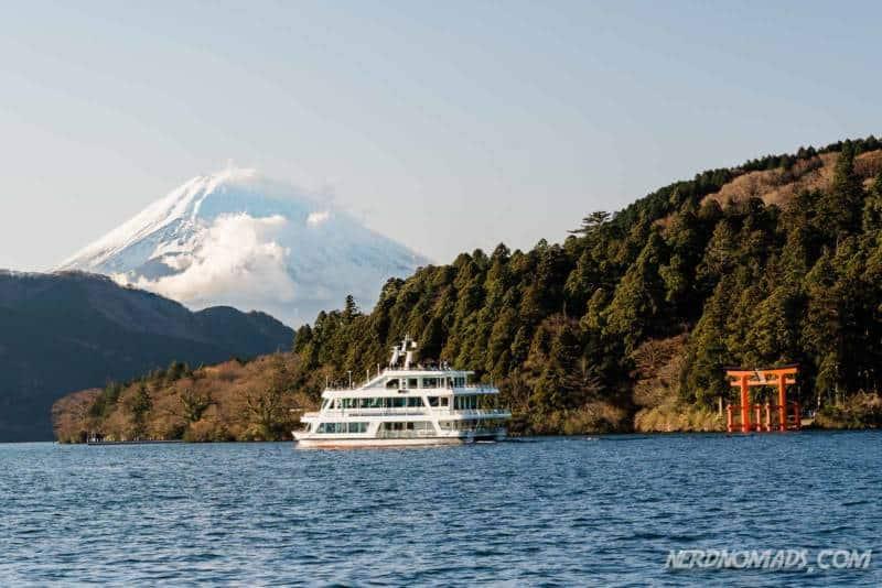 Red floating torii gate and Mount Fuji at Lake Ashi in Hakone