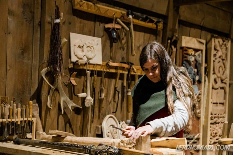 Artist working on wood carvings at Lofotr Viking museum