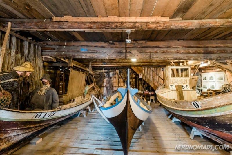 Lots of wooden fishing boats at Norwegian Fishing Village Museum A Lofoten